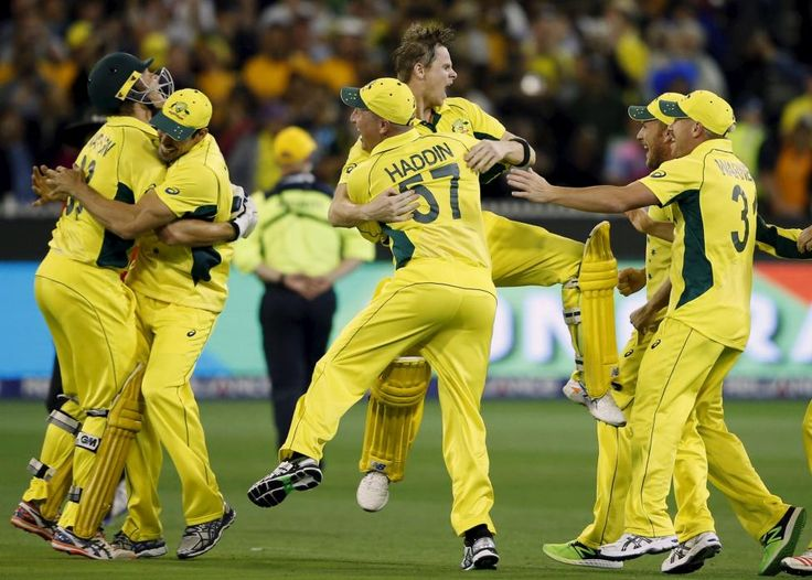 Australian players celebrate after defeating New Zealand in their Cricket World Cup final match at the Melbourne Cricket Ground, March 29, 2015. REUTERS/Jason Reed