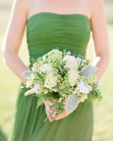 Bridesmaid bouquet: roses, ferns, chinaberries, snowball viburnum, rosemary, and dusty miller