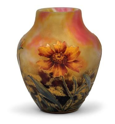 An overlaid and etched glass vase by Daum,