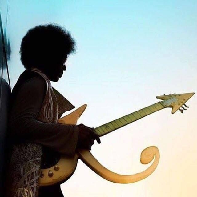One of last pictures of Prince. Him with one of his symbol guitars.