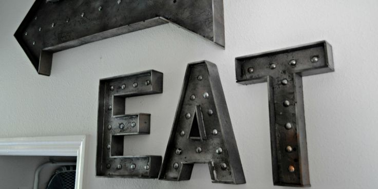 Faux metal sign.  Normally not a big fan of letters/words as decor, but I like the faux metal technique and the rivets on this one.