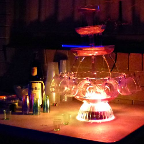 Light-up drink fountain filled with Moscato | Black Light Party | Cosmic Events