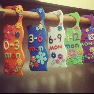 DIY baby clothes dividers. Foam doorknob hangers from a craft store. Foam numbers & decorations.