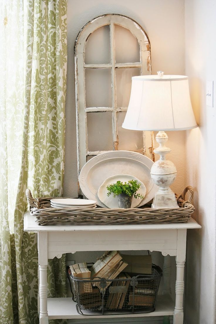 Display Idea - a salvaged window and bundles of books in a basket.  The Farmhouse Porch