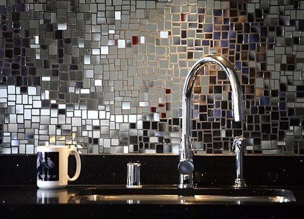 Mirror tile backsplash. Mosaic is a great technique for inexpensive home design. Plus, since granite companies will often give away imperfect and broken pieces, you can decorate the garden with large scale mosaic patterns!