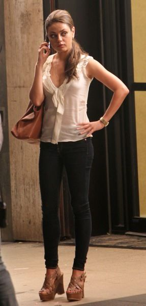 Mila Kunis in stacked wedges                                                                                                                                                                                 More