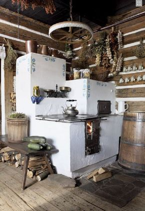 masonry cook stove. Ok, love the cooktop, masonry, oven combo. Needs built-in bench on the side and once again, no floral schmutz.