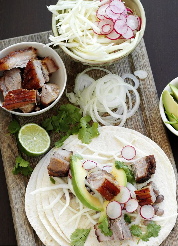 Worth every bit of effort: with melting slow-cooked pork and fresh radish and avocado salad this is a great help-yourself meal to share with friends.