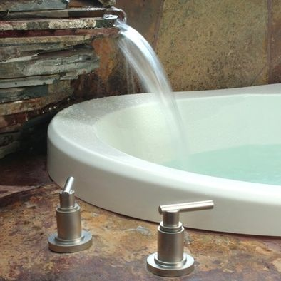 Unique bathtub fill...via waterfall! The other fixtures a tad too contempo for me. But I love the idear!