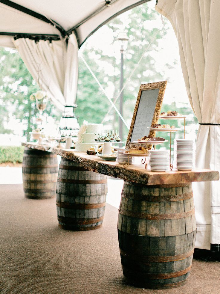Table at the reception made out of wine barrels. Perfect for a winery wedding, or even a rustic wedding too!