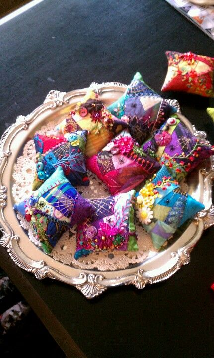 My crazy quilted pincushions.