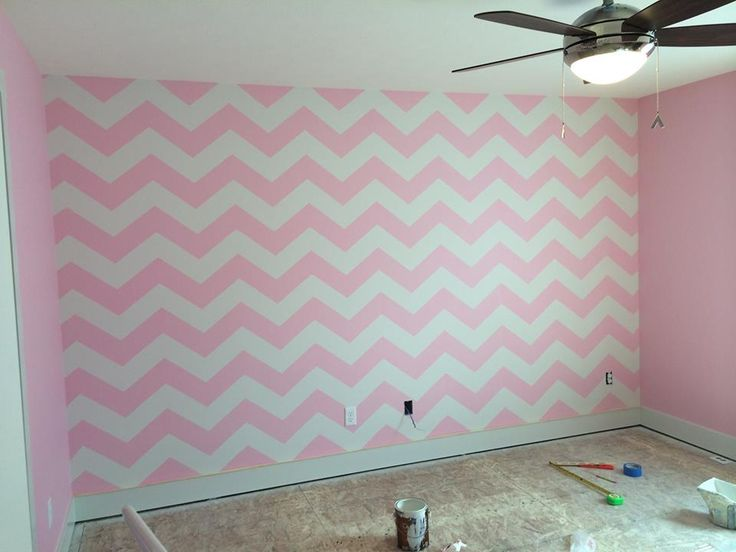A pink and white chevron allover stenciled accent wall in for Chevron template for walls