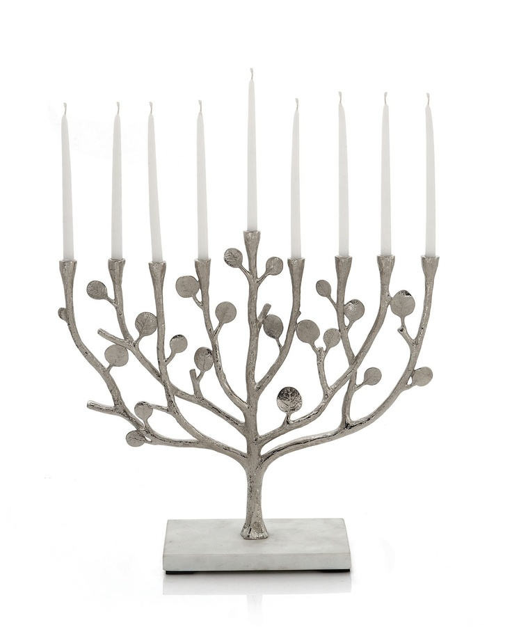1. The innovative botanical leaf design really drew me to this piece. 2. My Jewish lifestyle is the meaning behind my choice. I like to incorporate religious details into my home.