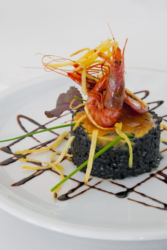 Arroz negro de sepia al ai i oli gratinado. (#Mallorca, Balearic Islands, #Spain). Enjoy the typical Majorcan cuisine in our hotel-restaurant, a typical Catalonian country house, at the foot of the Puig de Randa.    http://www.esrecoderanda.com/