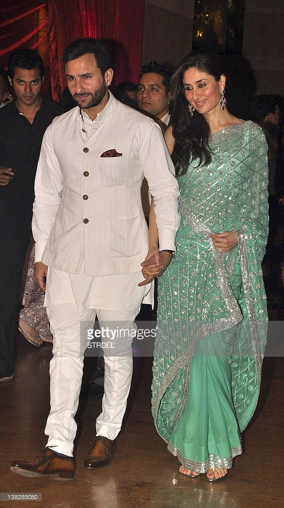 Indian Bollywood personalities Kareena Kapoor (R) and Saif Ali Khan attend the wedding reception of actors Ritesh Deshmukh and Genelia D'Souza in Mumbai on February 4, 2012.