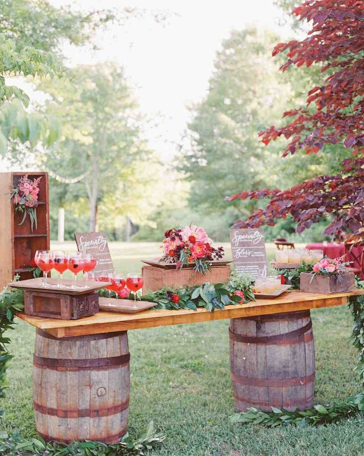 Trending Now: Drink Stations to Elevate Your Reception | Martha Stewart Weddings - Wine barrels were used as the base of this sangria bar, giving a nod to the main ingredient in the couple's signature drink. To balance out taste preferences, the bride and groom also had Old Fashioneds available. The most important thing to note about this bar is that the cocktails are pre-prepared, meaning guests can pick up a cocktail on their way to the reception without any wait.
