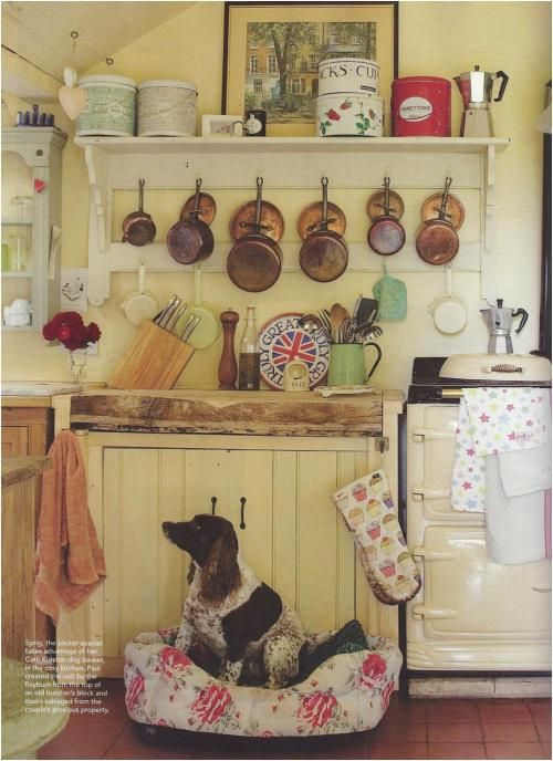 "Old world kitchen from English Home. Per roomology ""....I also like how the pans and lids are hung, as it's often annoying to try to root through your lids looking for which one goes with which pot."""