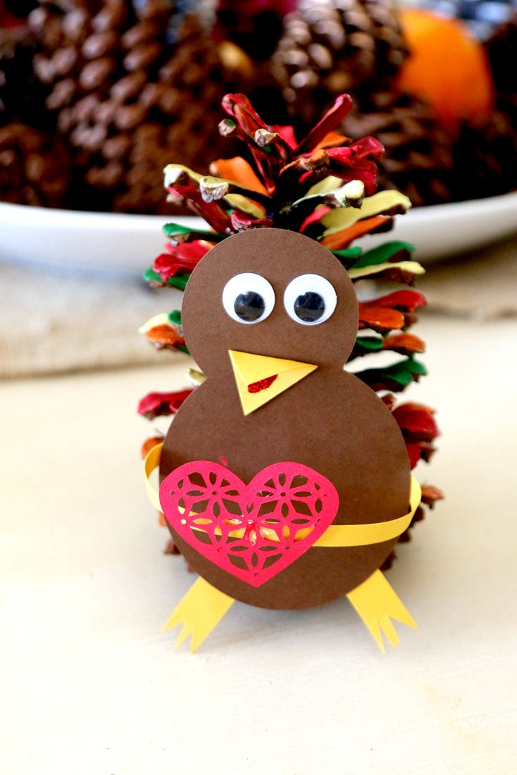 Painted Pine Cone Turkeys - Love this adorable and fun craft for the kids by MomDot