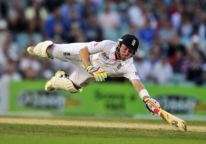 England's Ian Bell dives to make his ground during play on the fifth day of the fifth Ashes Test match between England and Australia at The Oval cricket ground in London