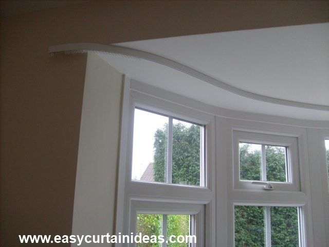 Flexible curtain rods are good for bay windows or other areas where one straight rod won't work.