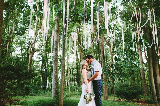 how fun are the streamers draped from the trees in this intimate backyard wedding?