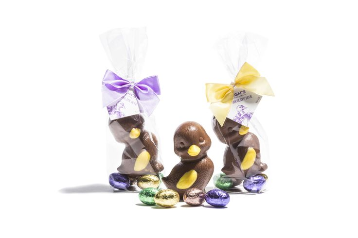 Hand decorated milk chocolate duck with milk chocolate mini eggs in cello bag. Perfect for giving this Easter.