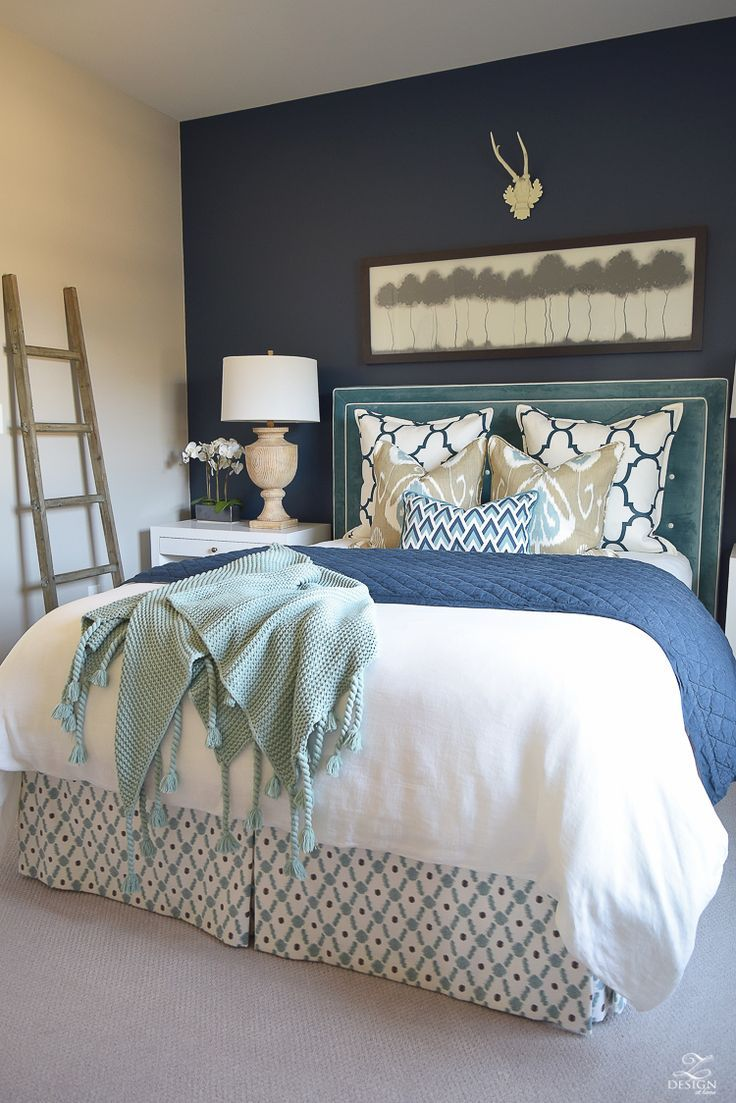 white bed cover with headboard for guest bedroom ideas have lampshade on white nightstand navy blue painted wall