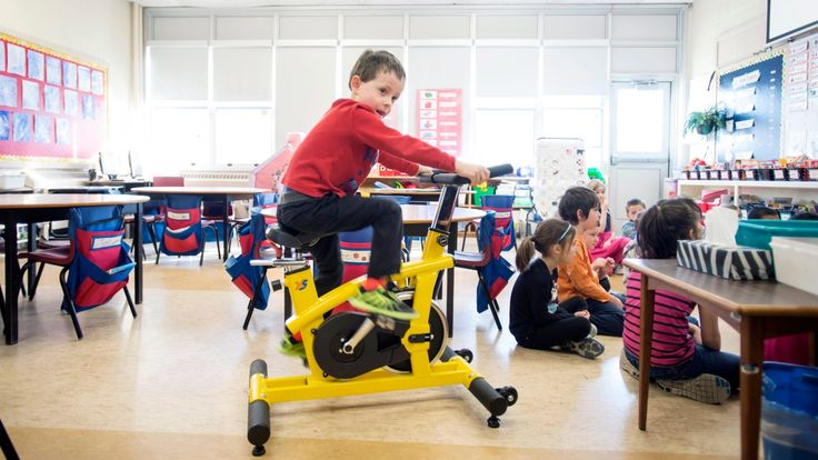 """A growing number of Canadian elementary schools have added stationary bikes in classrooms to help students focus on learning. Teachers have noticed an increase in attention span in class. The Current looks into the philosophy of """"self-regulation"""" behind the program."""