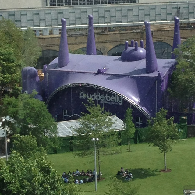 The is udderbelly an upside-down giant purple cow tent used as an event venue. Seen from the London Eye in Southbank. & The is udderbelly an upside-down giant purple cow tent used as ...