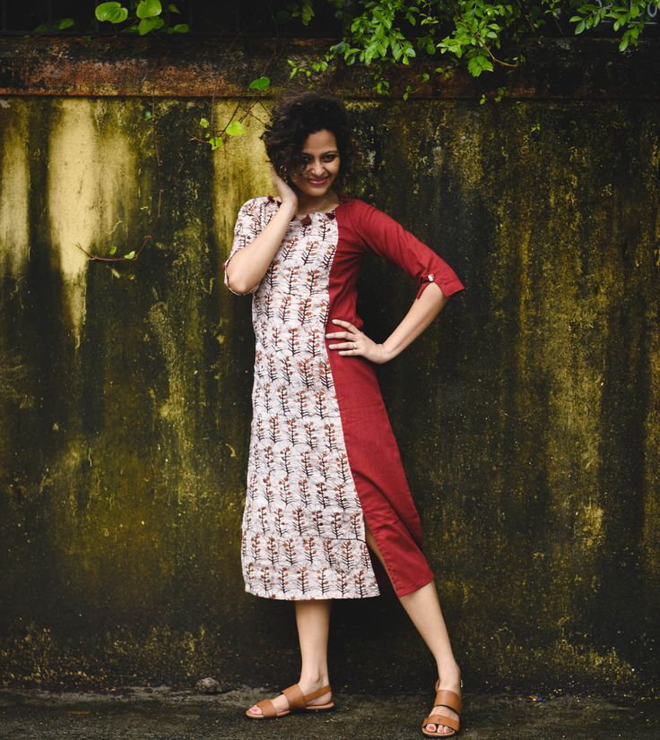 Pom-pom details and flared silhouette are the new 'IN' thing and this kurta dress has it all! Maroon slub fabric panelled with the beauty of batik art, slits along the hem and pattern reversal on the back makes this one unique. STYLE TIP: Team it with a pair of sneakers to channel your fusion persona. This beautiful piece has been crafted exclusively for Rustorange by designer duo Amit & Shruti Size Information: SMALL (S) : Shoulder - 13.5'', Bust - 35'', Waist - 33'', Length - 35....
