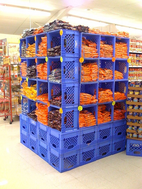 Storage shelves with stacked milkcrates, open side facing front, like cubbies: