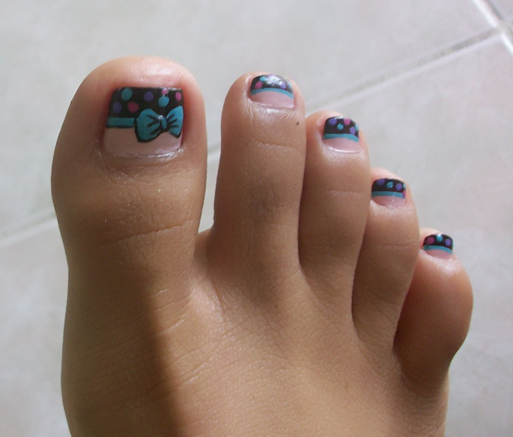 French tip toe nail design with bow and polka dots. Cute colors.