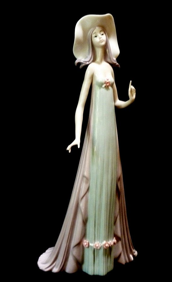 Lladro The Debutante $400 Designer: José Puche  Year designed: 1982  Year retired: 1998  Limited edition: --  Height: 13 3/4 inches  Width: 6 1/4 inches SALE $150