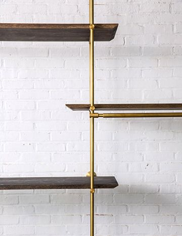 The Collector's Shelving System | Amuneal -  Framework in solid brass with warm finish.  Oxidized oak shelves with knife edge