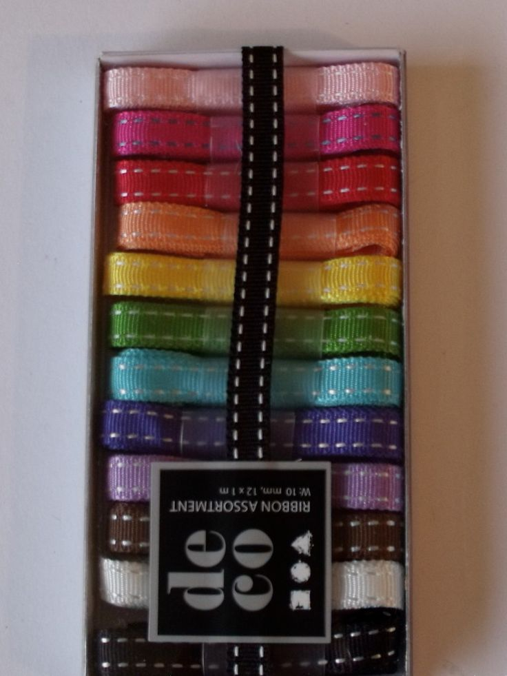 WOODWARE RIBBON COLLECTION - STITCHED GROSGRAIN 12 COLOURS 10mm x 1m      Box of stitch pattern grosgrain coloured ribbons with 12 m of ribbon in 1m lengths. This is a very soft ribbon in a rainbow of colours.