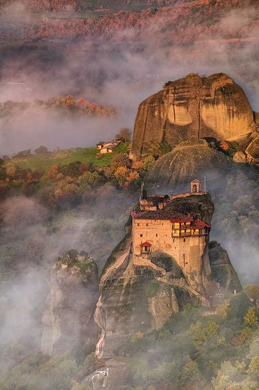 Meteora - Greece. Meteora (Greek: Metéora) is one of the gems of Greece. Located near the towns of Kalampaka and Kastraki in northwestern Thessaly it consists of a number of rock pinnacles topped with a total of 24 monasteries.