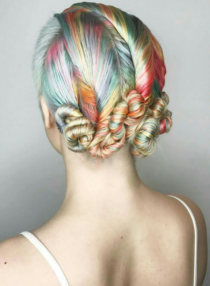 Love how the buns accent the rainbow hair photo: Shelly Gregory Hair