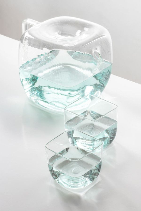 The shape of Water Pitcher Block feels and looks much like an oversized ice cube that can be filled up with water and ice through a small hole on the top that also protects the water from dust. http://design-milk.com/water-pitcher-block-antonio-arico/