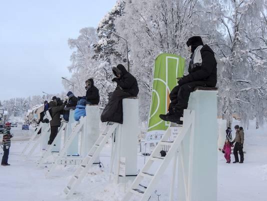 Six winners in the Swedish ice pole-sitting contest.