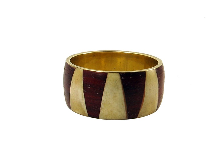 This single wide band in contrasting butter cream and rich brown is an elegant bangle. This bangle is about an inch in width with brass inner ring. A substantial piece of jewelry.
