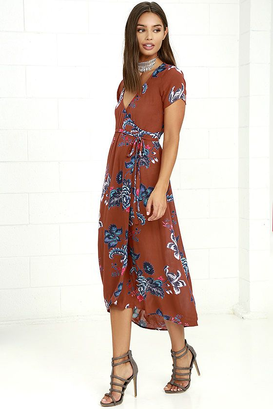 Remember that dress you wish you'd bought? Don't let it be the Billabong Wrap Me Up Rust Red Floral Print Wrap Dress! Blue, white, and pink floral print decorates gauzy woven rayon as it shapes short sleeves and a wrap bodice with waist tie. Midi skirt has a slight high low hem. Metal logo tag back.