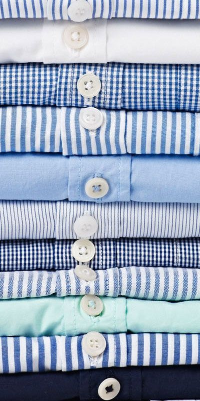 Somerset Prep : button down shirts in every shade of blue. stack of shirts.