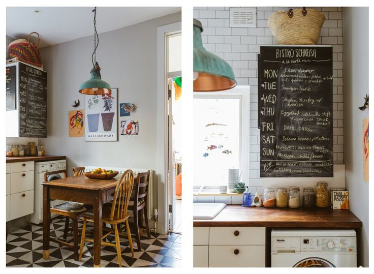 Crafty use of a blackboard menu to disguise a boiler cupboard in the kitchen. Also: mismatched wooden chairs and table, black and white triangle tiled floor & gorgeous verdigris and copper lampshade