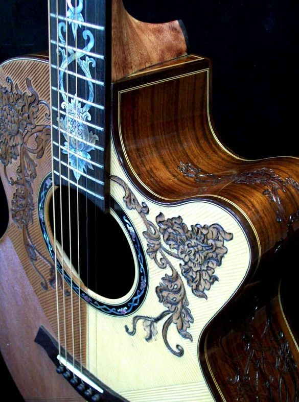 "A beautiful, all handmade acoustic grand concert guitar with ""Floral"" theme carvings on the body and headstock"