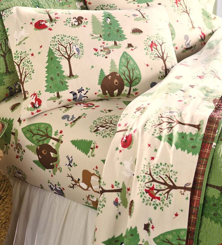 Woodland Friends Flannel Sheet Set  features a forest of furry friends, including deer, foxes, bears, rabbits and more on a cream background.