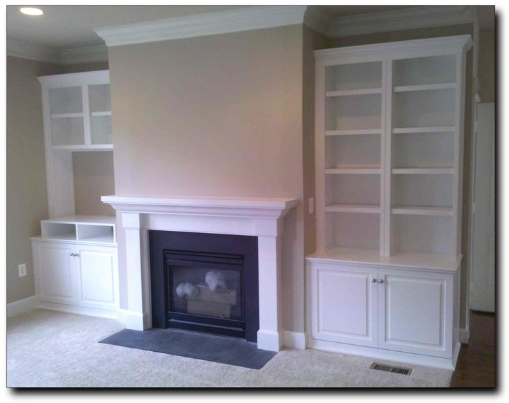 Love the space for the tv that is not over the fireplace for Fireplace cabinet ideas