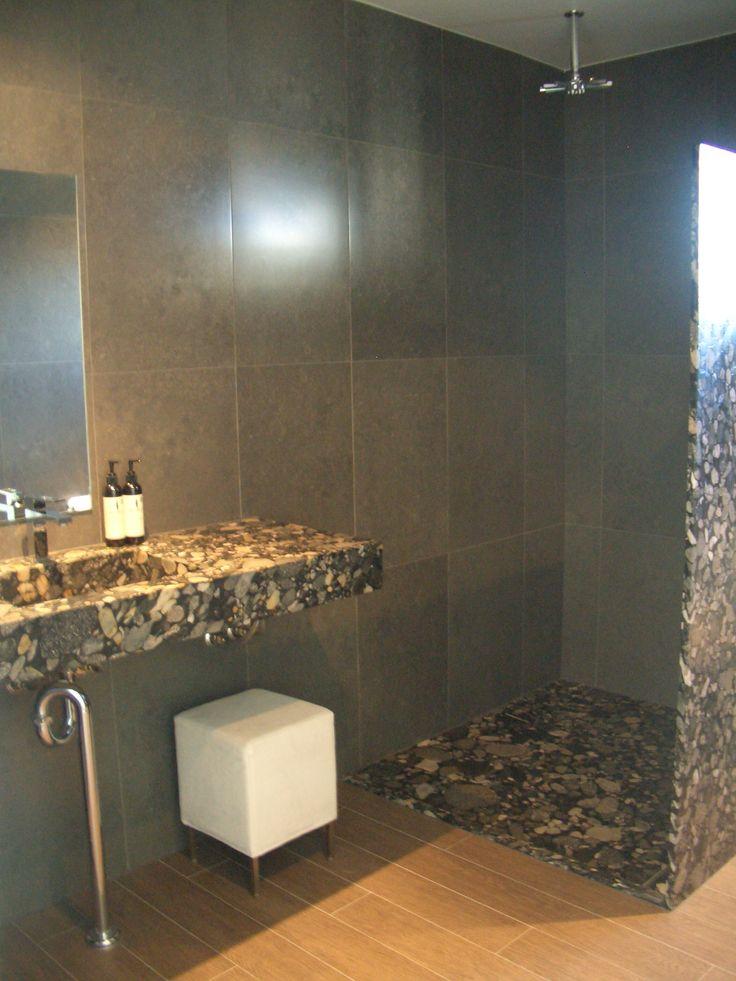 Black Marinace Granite vanity, shower floor and wall. Timber-look porcelain tiles on floor and Porcelain tiles on wall. ace Sunshine Coast HQ. www.acestone.com.au