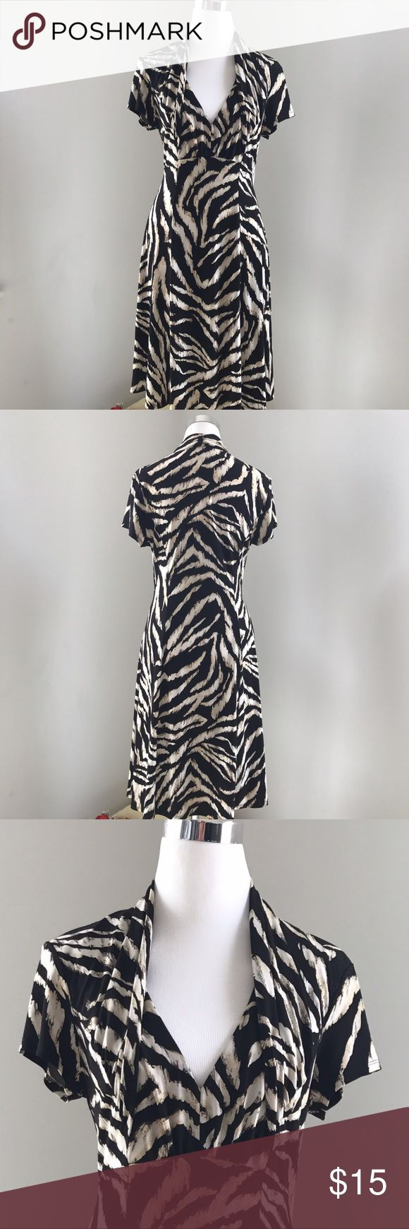 Connected Apparel Animal Print Dress Connected Apparel Black/Tan/Beige Animal Print Dress Short Sleeves V Neckline.  96% Polyester, 4% Spandex Short sleeves Machine wash cold, tumble dry low No buttons or zipper Lined bust    🎥For moving Visual visit my Instagram @Seamsewfitting414🎥 Connected Apparel Dresses Midi