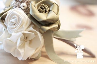 Here's a little something created for a winter bride. Olive & cream fabric flowers created from recycled ribbons with crystal, pearl & feather accents, finished off with a soft mint velvet ribbon. Hand crafted flowers using a very eco-conscious technique - without the use of glue. They are all hand-sewn & wired into an arrangement.
