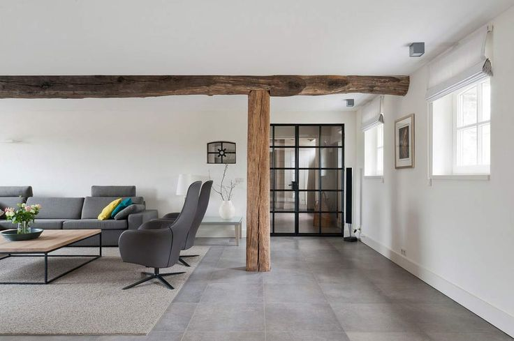 A solid wooden pole will gives the touch of nature while relaxing in the living room that give a taste of modernist.
